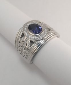 Silver Rings - 7mm Blue Oval Cut Cubic Zirconia with Leaf Detail