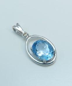 Silver Pendants - 9x7mm Oval Blue Topaz & Diamond