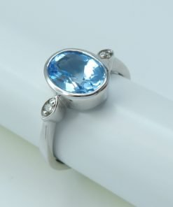 Silver Rings - 9x7mm Oval Blue Topaz and Diamond