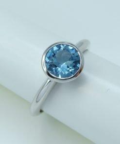 Silver Rings - 7mm Tube Set Blue Topaz